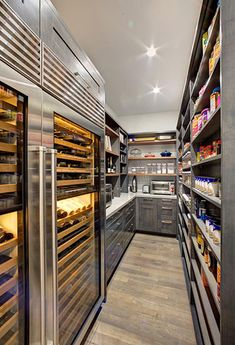 Walk In Home Pantry with Double Sided Wine Refrigerator This state of the art walk in pantry includes ample storage, dual wine refrigerators, a Caesarstone countertop for extra work space, and plenty of open shelving for dry foods storage. - Own Kitchen