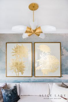 Gold leaf art hangs side-by-side from an elegant blue wallpapered wall over an ivory sectional topped with blue, gray, and white pillows and lit by a white and gold chandelier. Sophisticated Living Rooms, Transitional Living Rooms, White Farmhouse Table, Mismatched Furniture, Alice Lane Home, Country Modern Home, Cool Kids Bedrooms, Gold Leaf Art, Cottage Art