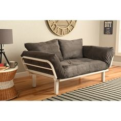 This unique and versatile lounger easily converts from a chair to a lounger or bed. This contemporary, stylish, metal frame a white powder-coated finish and is highlighted with a stylish upholstered mattress and two pillows.