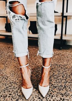 Chic heels with trendy distressed denim jeans.