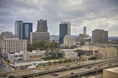 View Of Downtown Birmingham From The Uptown Entertainment District At The Birmingham-Jefferson Convention Complex & Arena Birmingham Skyline, Skyline Painting, Magic City, Sweet Home Alabama, San Francisco Skyline, New York Skyline, Lol, America, Building