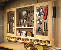 Garage sliding door pegboard cabinet building plans - this could be super useful in a craft room too (paint it white or a pretty color and store craft supplies, etc). might have to coerce dad into building this for me! Workshop Storage, Garage Workshop, Tool Storage, Storage Ideas, Garage Storage, Diy Storage, Pegboard Storage, Workshop Ideas, Workshop Cabinets
