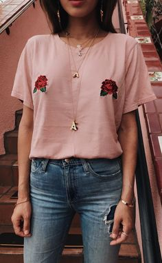 Pink rose tshirt with high waisted jeans.