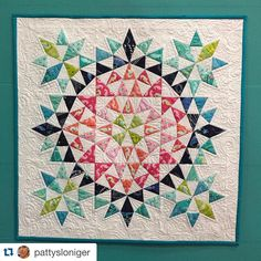 Beautiful mini in @pattysloniger 's booth at #QuiltMarket by @mumziepooh #IntotheDeep LOVE