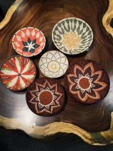 Baskets are one of mankind's oldest forms of art. Woven within its natural fibers are patterns representing motifs such as family, friendship, nature, and desires of hope and unity. All Across Africa partners with rural communities throughout Africa...