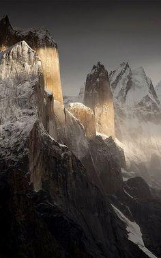 A stunning shaft of sunlight lands on a portion of the Karakoram Mountain range, Pakistan.