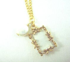 Gold photo frame and white fresh water pearl charm by ardorfire, $22.00
