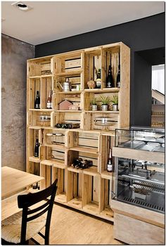 Have you ever thought of building a whole wooden cabinet out of wooden crates in your lounge or living area, then look below. the whole of the cabinet is built with wooden crates and the impact is just amazing. The wood in its natural grain is just looking awesome and stunning, providing ample storage space.