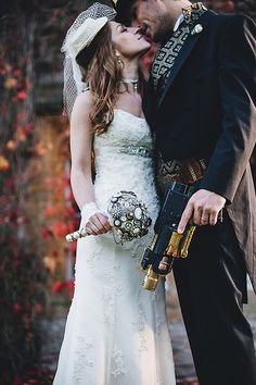 i love how she is in a timeless dress, but with accessories and him, it fits the theme perfectly!