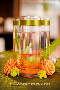 simple center piece clusters of vases & orange with ferns