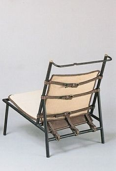 Jacques Adnet; Enameled Metal and Brass Lounge Chair, c1950.