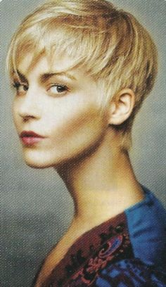 This is a super cute pixie hairstyle that has a little bit of an edge because of the choppy layers and extreme choppy bang.  This particular pixie haircut requires a thicker texture of hair to achieve the desired results.  Blow-dry forward while lifting the hair as you dry.  Piece out with wax and finish with light-hold hairspray.