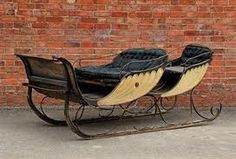A cream and livery-painted horse-drawn sleigh. I'm kinda imagining my heroine and her friend riding in this one.