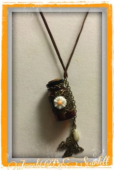 Butterfly Wishes    Amber colored glass bottle adorned with an antiqued metal butterfly and a cute little daisy to top it. Hanging from the bottle is another antiqued metal butterfly and another piece with a beautiful pearl.      #wish #amber #bottle #butterflies    #daisy #pearls | Shop this product here: http://spreesy.com/JewelsByScarlett/143 | Shop all of our products at http://spreesy.com/JewelsByScarlett    | Pinterest selling powered by Spreesy.com
