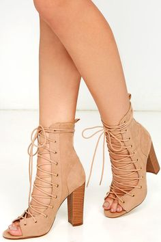 """We say """"get it girl"""" when it comes to the Sierra Beige Lace-Up High Heel Booties! These sexy high-heel booties are made from soft, vegan suede, with a peep-toe upper, lace-up vamp, and mid-calf shaft with pull tab."""