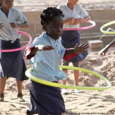 """Meet 8-year-old Tarcizia Narcizo Nguzi who loves hula hooping. """"I have already done it ten times today,"""" she says. """"I will be a doctor when I grow up, and I will tell my patients to hula hoop. My teacher says it is good for exercise.""""  Tarcizia's school was given more than 50 hula hoops, as part of the sports kit provided through the Child-Friendly Schools initiative."""