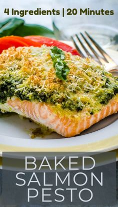 Want the best baked salmon recipe? Try Salmon with pesto sauce. Only 4 ingredients and 20 minutes needed for quick and easy Baked Salmon Pesto. #bakedsalmon #quickandeasydinnerrecipes