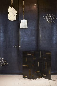Callidus Guild has taken over a nook in the studio, decorating it with black and gold wallpaper, a matching room divider and a series of mirrors.