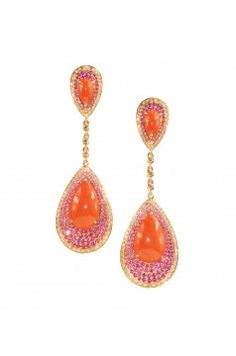 Wendy Yue-pear-shaped coral cabochons is enhances by the surrounding pink rubies and pink sapphires