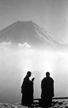 Monks in early morning contemplation of Mount Fuji, 1961, by Burt Glinn (AKEMASHITE-OMEDETOU-GOZAIMASU.)