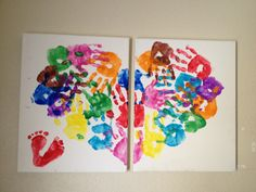 Children's handprints, multicolored to make the shape of a heart and infant foot prints at the bottom to make a tiny heat  <3