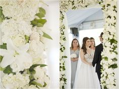 floral arbor, all white flowers, ceremony decor #fleurtaciousdesigns -Tiffany Wayne Photography
