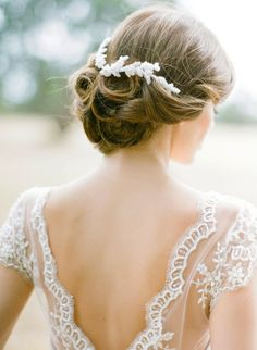 Another fabulous half coronet shimmering with crystals would look enchanting and balletic in any bridal hairstyle whether the bride wears her in a simple updo (as shown) or up in a more elaborate style, or in a half-up style, or even down