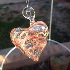 A personal favorite from my Etsy shop https://www.etsy.com/listing/262581386/handmade-hanging-glass-heart-free-form