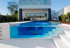 OFTB integrates contemporary landscape design with high quality construction of concrete swimming pools, this stunning transparent pool is from a house in Elsterwick, Melbourne.