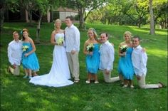 These bridesmaids aren't short They're sitting on the groomsmen's knees. lol