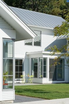 This modern farmhouse was custom designed by TruexCullins Architecture + Interior Design, located in Jericho, a town in Northern, Vermont. Contemporary Patio, Contemporary House Plans, Modern Farmhouse Exterior, Modern Farmhouse Style, Modern Barn, Farmhouse Ideas, Architecture Details, Interior Architecture, House Cladding