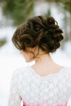 Wedding hairstyle - updo with loose curles and bangs to the side