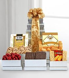 Holiday Giftbasket Shimmering Seasons Gourmet Tower. Dazzle them this Holiday season with a shimmering silver tower overflowing with gourmet sweets and savories! Each box is filled to the brim with tasty surprises. GOOD tower includes chocolate covered graham crackers, Walker's shortbread cookies, chocolate covered cherries, chocolate chip cookies and Sonoma cheese straws. BETTER tower contains all of the above plus Lindt truffles and Godiva chocolate covered pretzels. BEST tower holds all…