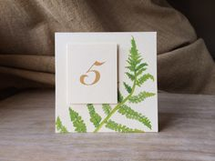 A personal favorite from my Etsy shop https://www.etsy.com/listing/209139337/fern-table-number-tents-for-events