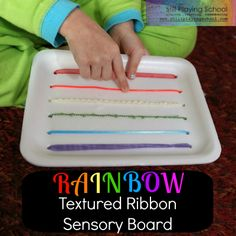 Still Playing School: Rainbow Textured Ribbon Sensory Board