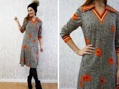 A 1970s Vintage Jersey dress patterned in orange, brown with flowers and stripes.