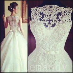 vintage sleeveless princess beaded lace and tulle wedding dress. $286.00, via Etsy.