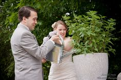 "For part of our ceremony, we decided to plant a wedding tree (ok, by ""plant"" I mean symbolically put dirt and water in and by ""tree"" I mean lilac, because they are awesome.) It was fun and unique and I got to put on gloves - not gardening gloves like I originally thought but my great grandmother's fancy gloves, which were equally cool :)"