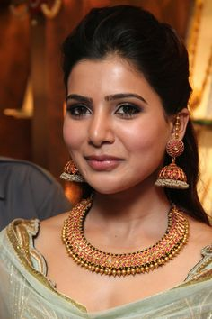Samantha in antique ruby choker with gold beads and ruby and pearl jumkas at Prince jewellers