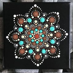 For sale is a hand-painted Mandala on a 6x6 canvas. Painted with high-quality acrylic paints, with a gloss acrylic finish for protection. Colors in this Mandala are Aqua, Beiges/Browns and Orange. Each one is hand made and no two are alike