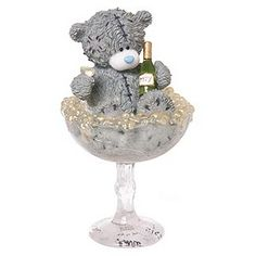 Tatty Teddy is busy celebrating in this fun Me To You collectible, enjoying a glass - or two! - of bubbly in a giant champagne glass. The perfect way to celebrate a special occasion, this figurine makes for a charming celebratory gift.