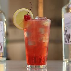 AMERICAS ICED TEA  (User Submitted - Joey R) 1 oz. (30ml) Vanilla Vodka 1/2 oz. (15ml) Rum 1/2 oz. (15ml) Gin 1/2 oz. (15ml) Tequila 1/2 oz. (15ml) Cherry Vodka 1/2 oz. (15ml) Grenadine 1/2 oz. (15ml) Cherry Juice 1/2 oz. (15ml) Ginger Ale 1 oz. (30ml) Lime Juice 1 oz. Lemon-Lime Soda Garnish: Lemon Wheel/Cherry  PREPARATION 1. Add ice to tall glass and pour over liquors. Add lime juice, cherry juice and grenadine before topping with ginger ale and lem...