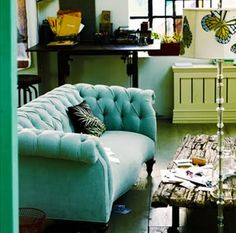 Turquoise love seat...awesome with that the other springy elements in this space!