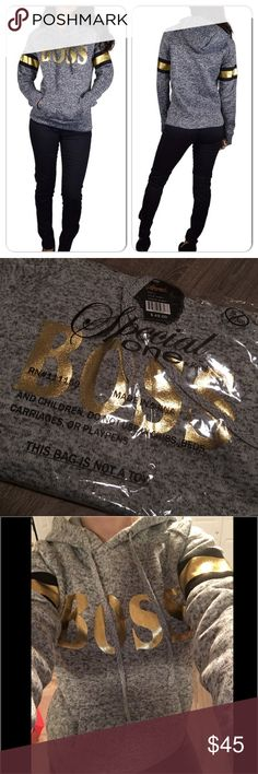 BOSS gray/gold hooded sweatshirt 1 Medium left! In love with this Really fun hooded sweatshirt with BOSS on the front in Gold letters. Gold decor on sleeves. Lightly fleece lined inside. Im modeling a small in the photo.  These seem to run a tad small. Tops Sweatshirts & Hoodies