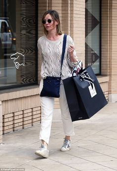 Hitting the shops: Calista Flockhart looked chic in shades of cream and white for a shoppi...