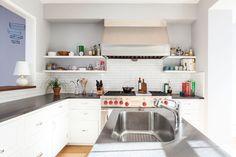 Floating shelves instead of upper cabinets. White kitchen