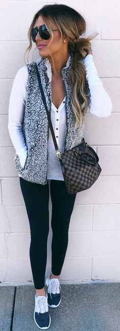 #winter #outfits white top, vest, leggings, sneakers