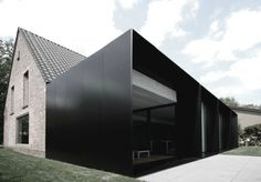 House DS  A typical Belgian farmhouse, known as a 'fernette' inspires this addition to a residence, House DS, with an expansive back garden in Destelbergen, Belgium. Architects Graux & Baeyens