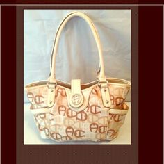 """Etienne Aigner Beige Handbag Shoulder Bag Large Pre-owned great condition handbag. Etienne Aigner Beige with Classic A Aigner print on bag. Leather straps. Small pen mark to upper right side/back inner lining. Bag height 11.5"""". Bag depth 11.5"""". Length 18.5"""". Strap drop 11"""". Great handbag. Such a nice size and roomy I used it as a diaper bag as well as a handbag. Etienne Aigner Bags Shoulder Bags"""