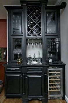 Timberland Cabinetry Company in Spring Hill, TN offers high-quality kitchen cabinets at affordable prices. We work with local clients and nationwide dealers, providing beautiful, functional cabinetry. Black Distressed Cabinets, Black Cabinets, Black Hutch, Wine Cabinets, Kitchen Cabinets, Built In Microwave Cabinet, Mini Bar, Cabinet Inspiration, Inspiration Design